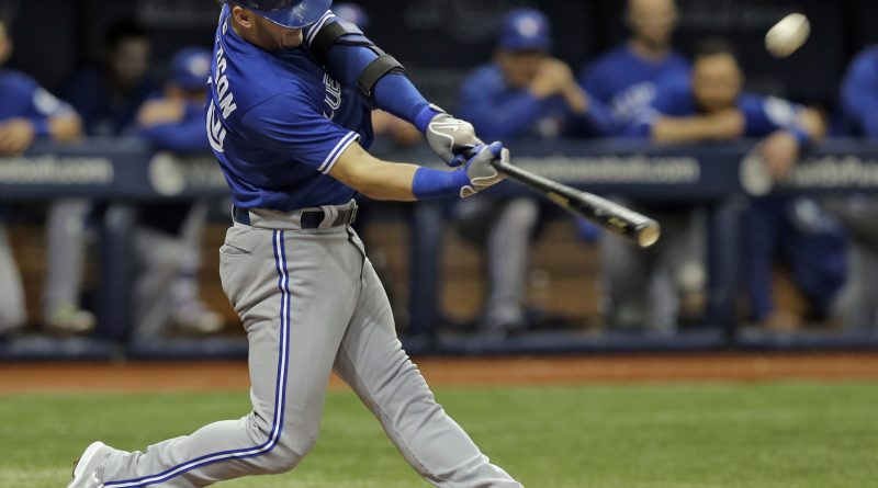 Toronto Blue Jays' Josh Donaldson connects for a three-run home run off Tampa Bay Rays starting pitcher Matt Moore during the third inning of a baseball game Wednesday, April 6, 2016, in St. Petersburg, Fla. (AP Photo/Chris O'Meara)