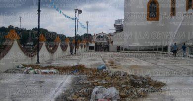 con-un-parche-de-cemento-tierra-y-arena-tapan-socavon-en-atrio-de-iglesia