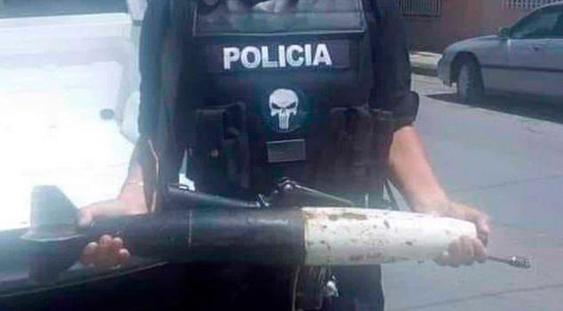 Mujer intenta canjear un misil por vales en Chihuahua