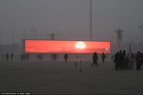 China emite el amanecer en pantallas gigantes por culpa de la contaminación
